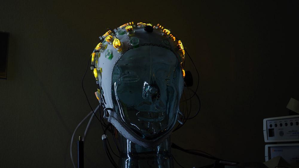 lit up electrodes on cap in a dark room