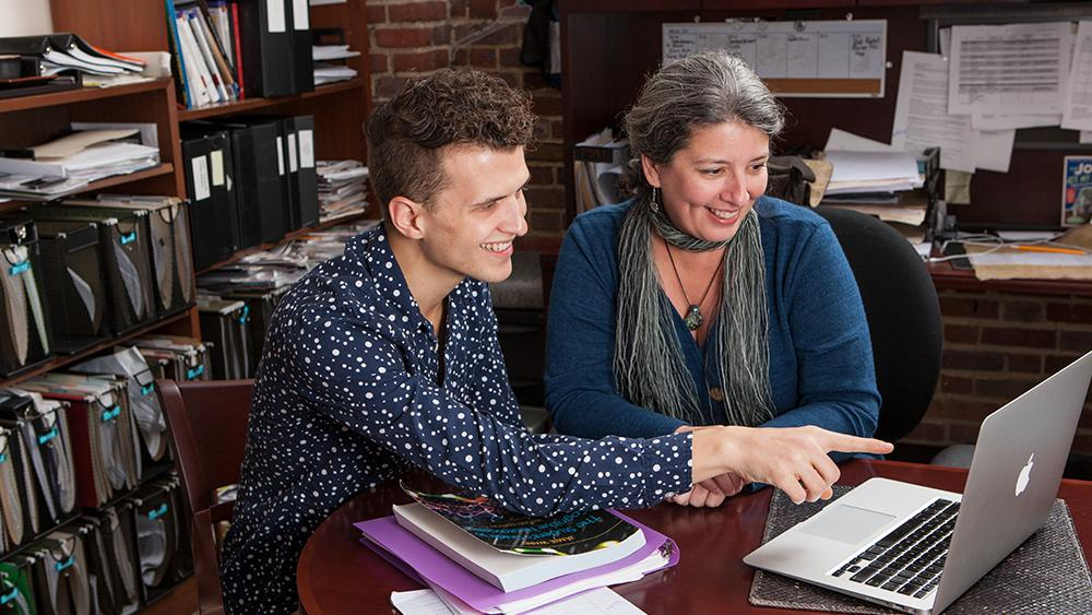 dr. bukach with a student working at computer