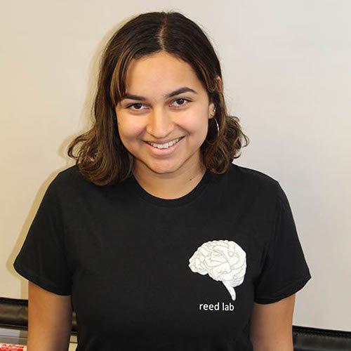 headshot of Aditi Chitre